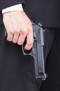 Yes, that is a gun in his pocket.